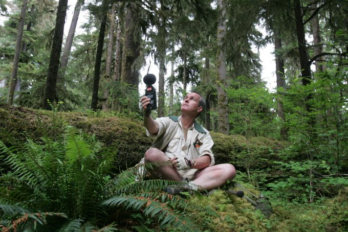 Sound recordist Gordon Hempton uses a meter to check the sound level in Olympic National Park