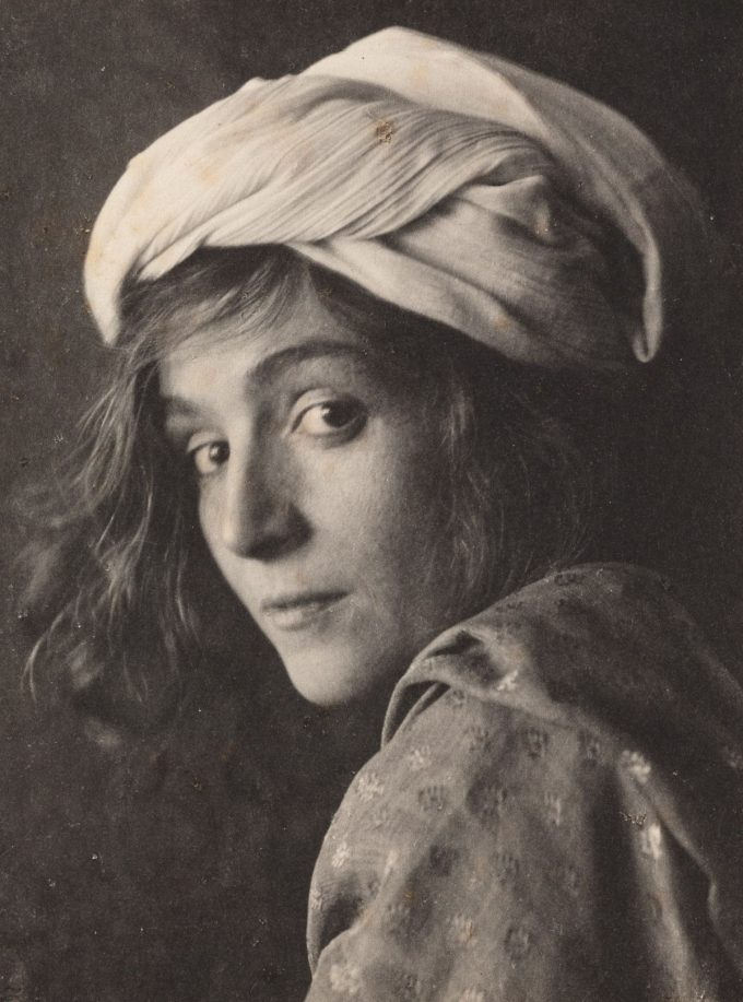 A platinum print by Fred Holland Day. An untitle portrait of a young women with turbin.