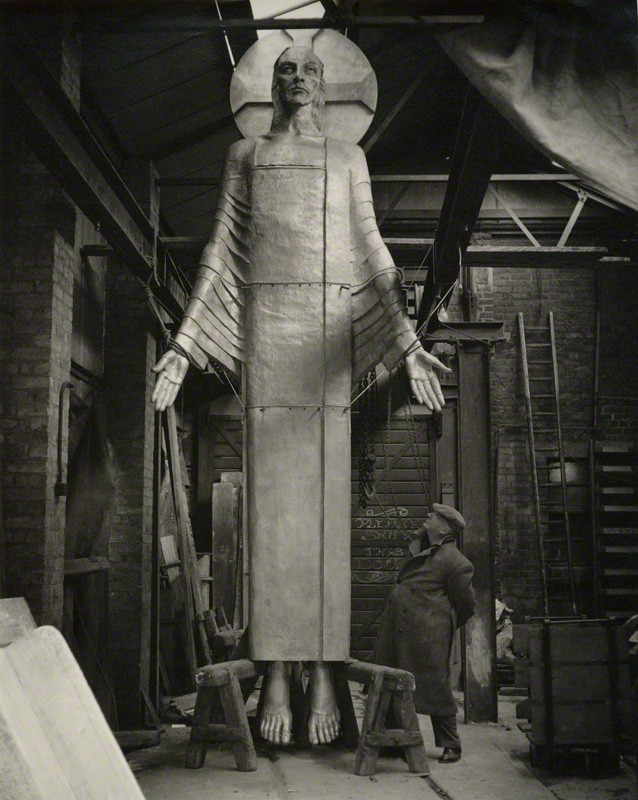 Jacob Epstein with his 'Christ in Majesty' by Geoffrey Ireland semi-matte bromide print, circa 1955 11 7/8 in. x 9 5/8 in. (301 mm x 245 mm)