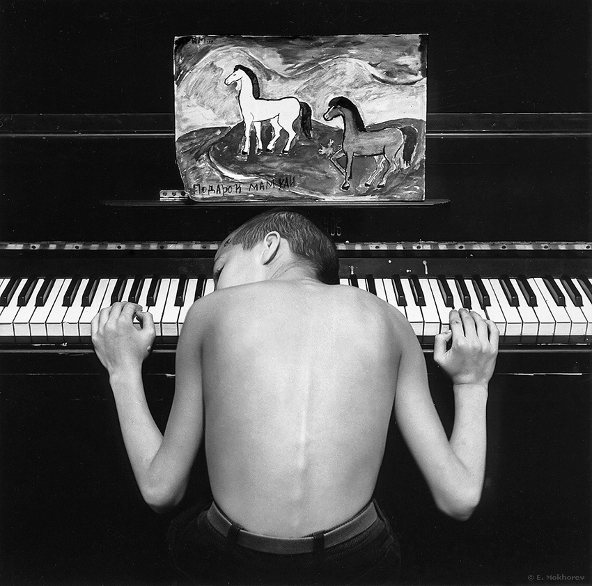 "Evgeny Mokhorevs Photography - ""Pause"" (Ksenia at the piano), St.Petersburg, 1992."