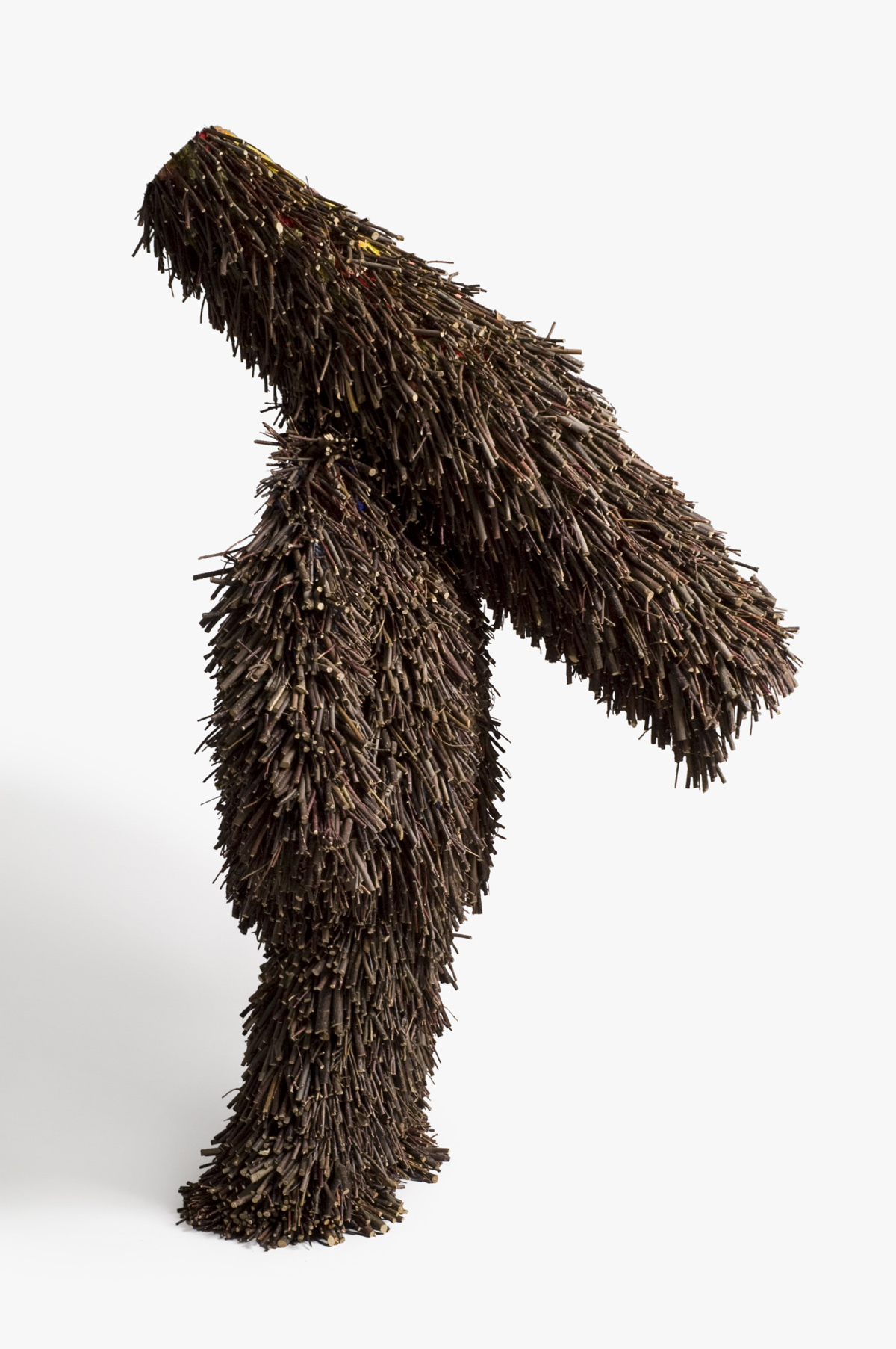 A photograph of one of Nick Cave's Sound Suites made of sticks