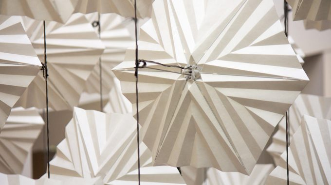Close up of individual origami element in the diffusion choir kinetic sculpture