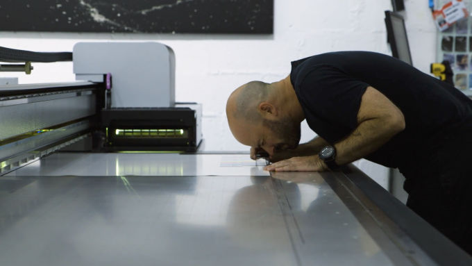 Justin Guariglia at his printer